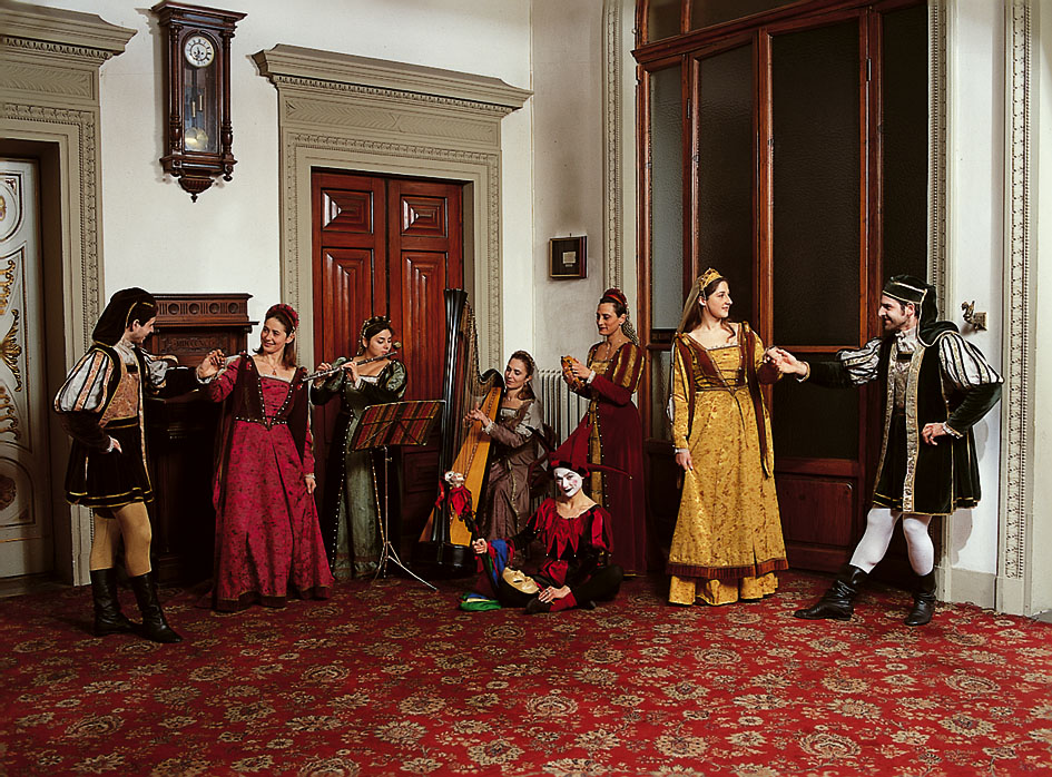 Renaissance party, vintage costumes, old musical instruments. Palazzo Borghese event venue in Florence